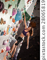woman bouldering in climbing gym 28065819