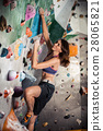 woman bouldering in climbing gym 28065821