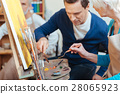Delighted artist helping elderly woman in painting 28065923