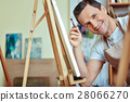 Happy artist smiling in painting studio. 28066270