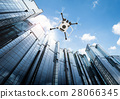 flying drone in city 28066345