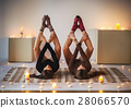 Two beautiful dancer posing in cozy room with candles 28066570