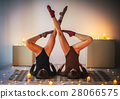 Two young women doing yoga asana supported shoulderstand on plai 28066575