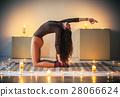 Young beautiful woman doing yoga asana half camel pose on plaid 28066624