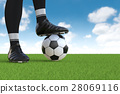 soccer player standing with soccer ball 28069116