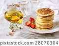 Pancakes with strawberries and herbal tea 28070304