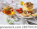 Pancakes with caramel sauce, strawberries and tea 28070419