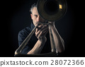 Musician with a trombone 28072366
