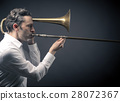 Musician with a trombone 28072367