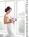 Stunning young bride holding bouquet 28075611