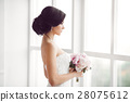 Stunning young bride holding bouquet 28075612