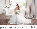Bride in beautiful dress sitting resting on sofa 28077632