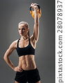 Active woman holding the weight 28078937