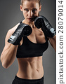 Ambitious woman posing with boxing gloves 28079014