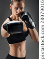 Delighted woman posing with boxing gloves 28079016