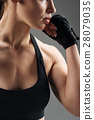 Close up of young woman posing with boxing gloves 28079035