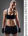 Young woman posing in sportswear 28079043