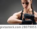 Confident girl wearing elastic sport bandage 28079055