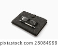 Black book with glasses and pen. 28084999
