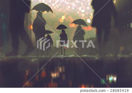 man holding umbrella standing alone in a crowd 28085419