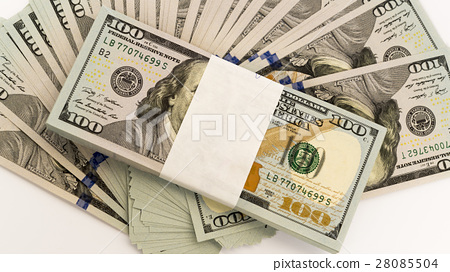 Stack of money in US dollars cash banknotes 28085504