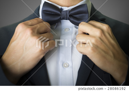 Close up on a man with a navy blue bow tie 28086192