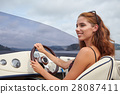 Summer vacation - young girl driving a motor boat 28087411