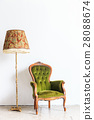 vintage armchair on white wall. 28088674