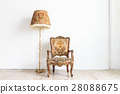 vintage armchair on white wall. 28088675