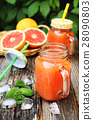 Grapefruit juice in two glass jar, open-air drink 28090803