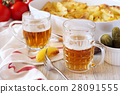 Fried potatoes and two mugs of beer 28091555