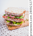 Sandwich with salami cress and cucumber 28092327
