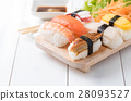 sushi with sauce and wasabi on wood plate 28093527