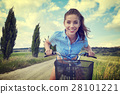 Sexy woman with vintage bike in a country road. 28101221