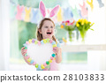 Little girl in bunny ears on Easter egg hunt 28103833