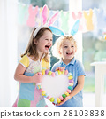 Kids in bunny ears on Easter egg hunt 28103838