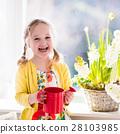 Little girl watering spring flowers 28103985