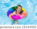 Little girl with toy ring in swimming pool 28104082
