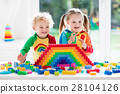 Kids playing with colorful blocks 28104126