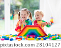 Kids playing with colorful blocks 28104127
