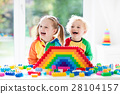 Kids playing with colorful blocks 28104157