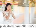 Buddhist girl praying inside the temple 28106653
