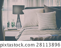 stylish bedroom with brown patterned pillow on bed 28113896