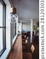 Hanging Light Bulb near glass window 28120303