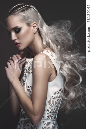 Beautiful girl in art dress with avant-garde 28129142