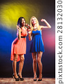 Two funny women in dresses. 28132030
