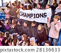 Cheering fans in stadium holding champion banner. 28136633