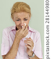 Senior Women Blowing Nose Concept 28144980