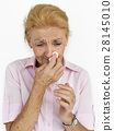 Senior Women Blowing Nose Concept 28145010