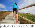 young fitness woman running on mountain stairs 28156701